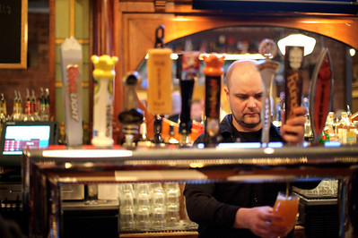 Daniel J. Murphy - dmurphy@shawmedia.com  Dukes Ale House bartender James Venters of Lake Barrington, IL pours a beer for a customer February 25, 2012 in Crystal Lake. Dukes Ale House features a large selection of craft beer and a menu full of fresh organic meal options.