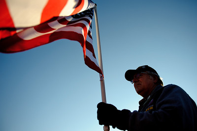 Daniel J. Murphy - dmurphy@shawmedia.com  Mike Vanderwyst of McHenry holds an American flag as US Marine Corps Aviator Matt Beers approaches Veteran Acres Park Saturday February 25, 2012 in Crystal Lake. Various veteran's groups organized a surprise welcome home ceremony for Beers.