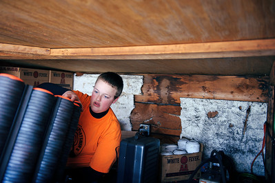 Daniel J. Murphy - dmurphy@shawmedia.com  Dan Strickfaden, 17, of McHenry reloads the trap house Sunday afternoon at the McHenry Sportsmen's Club February 26, 2012 in Johnsburg.