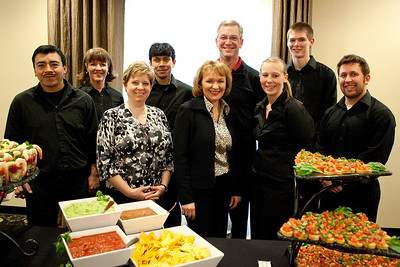 Mike Greene - For the Northwest Herald The staff at 31 North (217 N. Front St. McHenry) pose behind the hors d'oeuvres table prior to the start of a mixer for It's All About Kids Tuesday, February 28, 2012. The recently opened 31 North hosts a wide range of events with a special emphasis on giving back to the community.