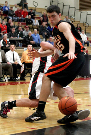 Jenny Kane - jkane@shawmedia.com  Huntley's Justin Frederick tries to bring down DeKalb's Kyle Berg as he scrambles for the ball during their IHSA Class 4A Huntley Regional game. Frederick suffered a nose injury after falling to the floor.