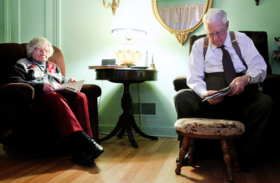 Jenny Kane - jkane@shawmedia.com Fred Etheridge, 95, puts away mail while his wife Fay Etheridge, 97, looks at family photographs during a family get together for their 75th wedding anniversary. The couple has three children and have lived in Crystal Lake for over 60 years.