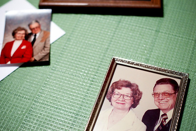 Jenny Kane - jkane@shawmedia.com Photographs of Fred Etheridge, 95, and his wife Fay Etheridge, 97, lay on their kitchen table during a family celebration of their 75th wedding anniversary. The couple has three children and have lived in Crystal Lake for over 60 years.