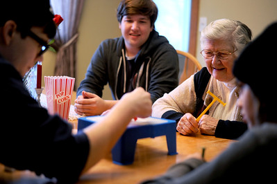 Sarah Nader - snader@shawmedia.com Zach Ciochon (center),19, and his brothers, T.J., 22, and Nick, 12,  play a game with their grandma, Guyette Hunter of Crystal Lake while at their home in Crystal Lake on Tuesday, February 28, 2012. Hunter has done a great deal of babysitting and basketball watching with her grandchildren which has led them to all be very close.