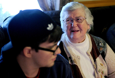 Sarah Nader - snader@shawmedia.com T.J. Ciochon (left), 22, watches an old Bulls game with his grandma, Guyette Hunter of Crystal Lake while at his home in Crystal Lake on Tuesday, February 28, 2012. Hunter has done a great deal of babysitting and basketball watching with her grandchildren which has led them to all be very close.