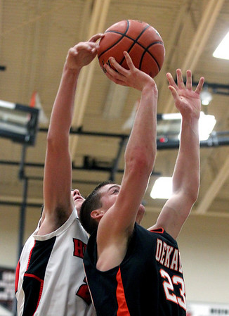 Jenny Kane - jkane@shawmedia.com  Huntley's Ryan Craig blocks DeKalb's Dan Matya's shot during the fourth period of their IHSA Class 4A Regional game.