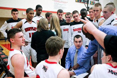 Jenny Kane - jkane@shawmedia.com Huntley's varsity boys basketball head coach Marty Manning talks to his team during a time out in their IHSA Class 4A Huntley Regional match-up against DeKalb.