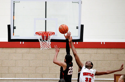 Jenny Kane - jkane@shawmedia.com Huntley's Amanze Egekeze tries block DeKalb's Andre Harris' shot  during their IHSA Class 4A Huntley Regional match-up.