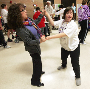 H. Rick Bamman -hbamman@shawmedia.com SEDOM Center School principal Kim Capranica and Krisa Dougherty dance Tuesday to music from the Beach Boys during the school's 2012 Homecoming beach party.