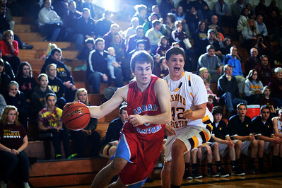 Daniel J. Murphy - dmurphy@shawmedia.com  Marian Central's Dustin Daily makes a move to the basket in the first quarter Wednesday February 29, 2012 at Johnsburg High School in Johnsburg. Richmond-Burton defeated Marian Central 40-36.
