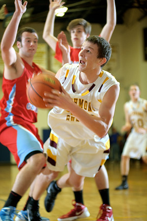 Daniel J. Murphy - dmurphy@shawmedia.com  Richmond-Burton forward Matt Rygiel (center) falls to the floor on a drive to the basket in the third quarter Wednesday February 29, 2012 at Johnsburg High School in Johnsburg. Richmond-Burton defeated Marian Central 40-36.