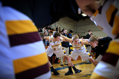 Daniel J. Murphy - dmurphy@shawmedia.com  The Richmond-Burton basketball team forms a circle as starters are announced against Marian Central Wednesday February 29, 2012 at Johnsburg High School in Johnsburg. Richmond-Burton defeated Marian Central 40-36.