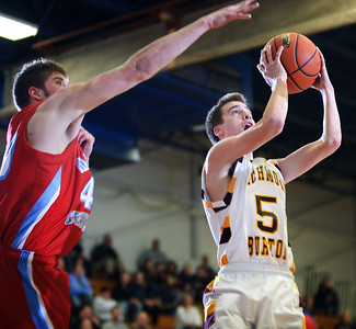 Daniel J. Murphy - dmurphy@shawmedia.com  Richmond-Burton guard Brian Wells (right) shoots past Marian Central's Kyle Thompson (left) in the third quarter Wednesday February 29, 2012 at Johnsburg High School in Johnsburg. Richmond-Burton defeated Marian Central 40-36.