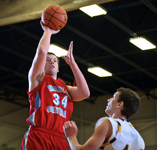 Daniel J. Murphy - dmurphy@shawmedia.com  Marian Central forward Zach Ricchiuto (left) shots a basket over Richmond-Burton forward Matt Rygiel (right) in the second quarter Wednesday February 29, 2012 at Johnsburg High School in Johnsburg. Richmond-Burton defeated Marian Central 40-36.