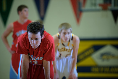 Daniel J. Murphy - dmurphy@shawmedia.com  Marian Central point guard Ross Kendzior (left) catches his breath before shooting a free throw in the first quarter Wednesday February 29, 2012 at Johnsburg High School in Johnsburg. Richmond-Burton defeated Marian Central 40-36.