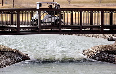 Sarah Nader - snader@shawmedia.com Golfers cross a bridge while playing golf at Whisper Creek Golf Club in Huntley during an unseasonable warm day on Wednesday, February 29, 2012.