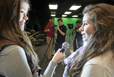 H. Rick Bamman - hbamman@shawmedia.com Barrington High School BHTV classmates Catherine Goetze, left and Ariana Balassano, rehearse interview style during class in the tv production studio as camera operators from left Matt Weidner, Chris Tessarolo and Tommy Lekai set equipment. (all names cq'd) 10 students created a video as part of a MOXIE contest judged by Rihanna. The video won, and as their reward, Rihanna is now going to visit the school