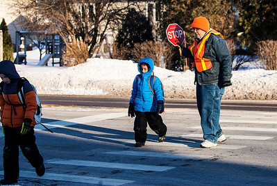Kyle Grillot - kgrillot@shawmedia.com   Bob Avery of McHenry helps Riverwood Elementary students to cross Crystal Lake Avenue during sub-zero degree temperatures Thursday in McHenry. Wind chill values as low as -30 are expected into Friday morning. A wind chill advisory is in effect until 11 a.m. Friday.