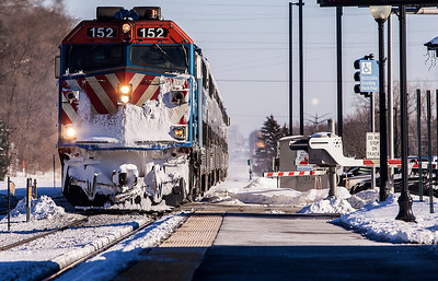 Kyle Grillot - kgrillot@shawmedia.com   An icy, outbound Metra train approaches the Cary station  Thursday, February 6, 2014. Wind chill values as low as -30 are expected into Friday morning. A wind chill advisory is in effect until 11 a.m. Friday.