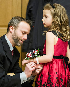 Kyle Grillot - kgrillot@shawmedia.com   Mark Matthaei of the Village of Lakewood attaches a corsage to his daughter Brynn, 6,  at the Cinderella Daddy Daughter Ball Friday in Crystal Lake. The event, sponsored by the Crystal Lake Park District, sold out all 150 tickets for the event.