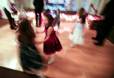 Kyle Grillot - kgrillot@shawmedia.com   Girls including Brynn Matthaei, 6, (center) dancing at the Cinderella Daddy Daughter Ball Friday in Crystal Lake. The event, sponsored by the Crystal Lake Park District, sold out all 150 tickets for the event.