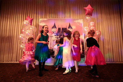 Kyle Grillot - kgrillot@shawmedia.com   As girls enter the building they first check out the princess' castle before dancing at the Cinderella Daddy Daughter Ball Friday in Crystal Lake. The event, sponsored by the Crystal Lake Park District, sold out all 150 tickets for the event.