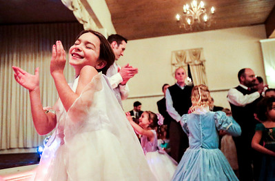 Kyle Grillot - kgrillot@shawmedia.com   Brooke Halwix, 4, of Crystal Lake sheers as the crowning is announced during a break from dancing at the Cinderella Daddy Daughter Ball Friday in Crystal Lake. The event, sponsored by the Crystal Lake Park District, sold out all 150 tickets for the event.