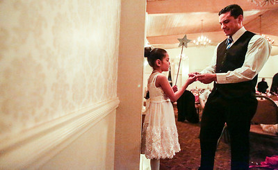 Kyle Grillot - kgrillot@shawmedia.com   Michael Langlois of Crystal Lake puts a bracelet on his daughter Kimberly,5, at the Cinderella Daddy Daughter Ball Friday in Crystal Lake. The event, sponsored by the Crystal Lake Park District, sold out all 150 tickets for the event.