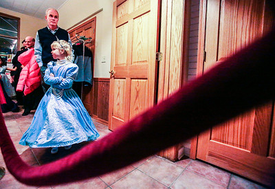 Kyle Grillot - kgrillot@shawmedia.com   Alyssa Johnston looks to other girls as they enter the building with her father Tom behind her at the Cinderella Daddy Daughter Ball Friday in Crystal Lake. The event, sponsored by the Crystal Lake Park District, sold out all 150 tickets for the event.