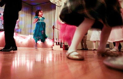 Kyle Grillot - kgrillot@shawmedia.com   Molly Mueller, 4, of Crystal Lake dances at the Cinderella Daddy Daughter Ball Friday in Crystal Lake. The event, sponsored by the Crystal Lake Park District, sold out all 150 tickets for the event.