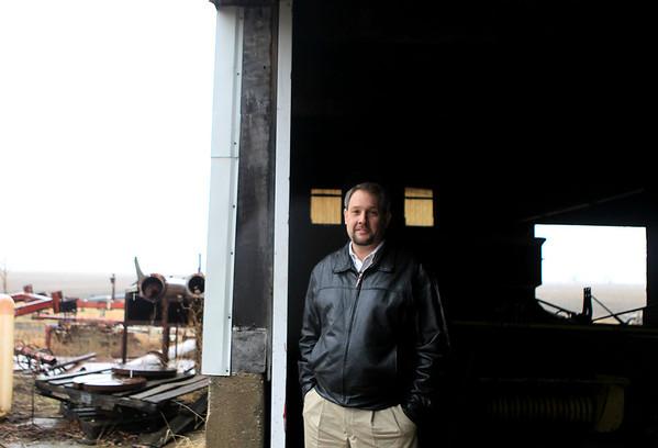Sandy Bressner - sbressner@shawmedia.com<br /> Scott Brummel of Brummel Land Realty stands in the barn of a 115-acre farm that is currently for sale in Virgil.