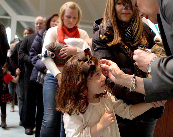 Sandy Bressner - sbressner@shawmedia.com<br /> Five-year-old Lily Hurh has ashes placed on her forehead as her mom, Marnie, looks on during a mass for Ash Wednesday at St. Patrick's Church in St. Charles.