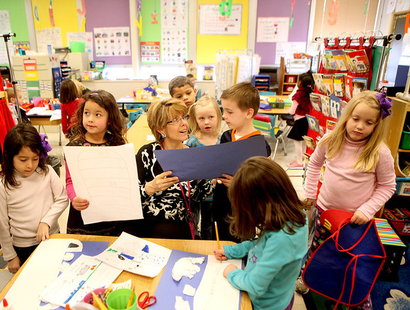 Sandy Bressner - sbressner@shawmedia.com<br /> Davis Elementary School teacher Marcia Marshall helps students in her all day kindergarten class with a project during a recent school day at the St. Charles School.