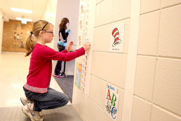 Sandy Bressner - sbressner@shawmedia.com<br /> Davis Elementary School second grader Libby Thomas votes for her favorite Dr. Seuss book during a recent school day at the St. Charles School.