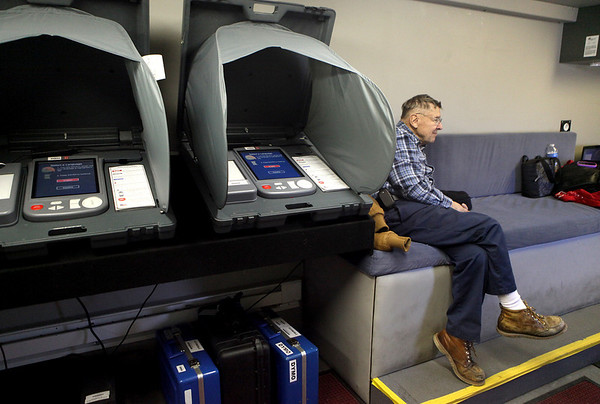 Sandy Bressner - sbressner@shawmedia.com<br /> George Huber of Elburn, an election judge and driver of the Votemobile site, sits in the mobile voting center on a slow first day of early voting while parked in the Jewel-Osco parking lot in Batavia Monday. Early voting runs through March 15.