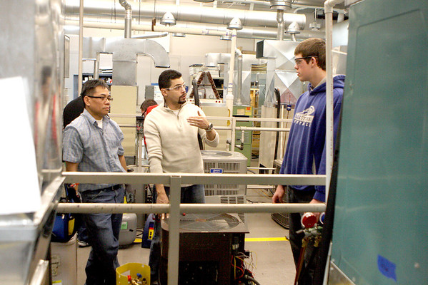 Sandy Bressner - sbressner@shawmail.com<br /> George Rosa (center), former student and current HVAC program coordinator at Elgin Community College, talks with students Galaxy Somsavath (left) of South Elgin and Joe Fish of Algonquin durng a lab class at the school Wednesday.