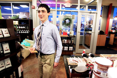 Sarah Nader - snader@shawmedia.com Bradley Jones, 17, of Crystal Lake hands out gift cards to customers at Conscious Cup in Crystal Lake in December. Jones did a random act of kindness each day in December. His actions included fill in up a person's gas tank, buying flowers for a stranger, baking cookies for a classmate and handing out gift cards to strangers.