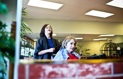 Josh Peckler - Jpeckler@shawmedia.com Terrie Mayer (left) of Island Lake talks with Carol Calcitrai, also of Island Lake as Mayer colors her hair at Power Salon in Crystal Lake. Mayer styles hair for some clients for next to nothing out of the goodness of her heart.