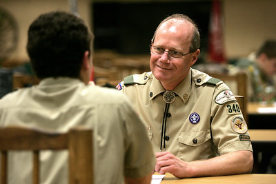 Monica Maschak - mmaschak@shawmedia.com Scout Master Edward Piesens meets with individual boy scouts from troop 340 for a Scout Master conference during a scout meeting in Spring Grove. Piesens still volunteers his time as the scout master even though his children have aged out of the scouts.