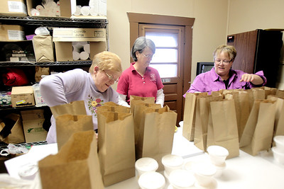 Sarah Nader - snader@shawmedia.com Volunteer Cheri Brockhoeft (left) of Cary. Dorthy Fagerson of Cary and Jayne Anderson of Poplar Grove pack meals for Golden Diners at the Kraus Senior Center in Cary. Anderson has been the director of the senior center for the past 12 years. She organizes events and activities for local seniors.