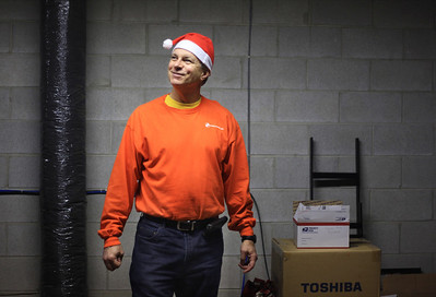 Sarah Nader - snader@shawmedia.com Mike Splitt poses for a portrait at his Insync Systems office in Crystal Lake. Splitt, who owns Insync Systems, was instrumental in organizing the Crystal Lake Kiwanis Club's first ever Santa Run in December.Nearly 700 runners, dressed in Santa outfits, raided money for Girls on the Run, Big Bros/Big Sisters, CASA and other organizations.