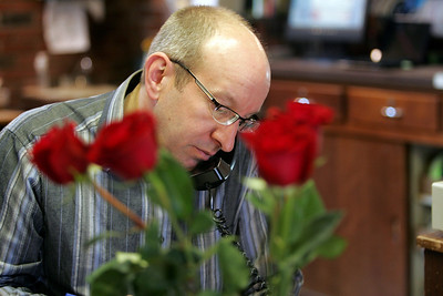 Monica Maschak - mmaschak@shawmedia.com Owner of Locker's Flowers John Dietrich takes a phone order in the McHenry store. Dietrich donates flowers to a nursing home, Alden Terrace, to be distributed to the women living there.