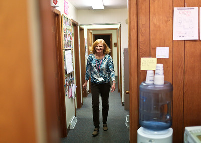 Josh Peckler - Jpeckler@shawmedia.com Elizabeth Phelps walks through the halls at Family Health Partnership Clinic in Woodstock. Phelps volunteers at the clinic three times a week contacting patients about appointments and medicine pickups.