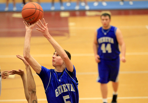 Sandy Bressner - sbressner@shawmail.com<br /> Geneva's Brendan Leahy tries to get a shot up during their game at Elgin Tuesday night.