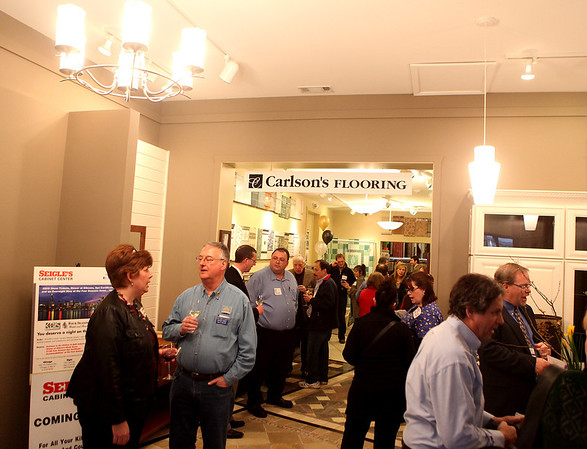 Sandy Bressner - sbressner@shawmedia.com<br /> Members of the Geneva Chamber of Commerce mingle during an after-hours event at Carlson's Flooring in Geneva Tuesday.