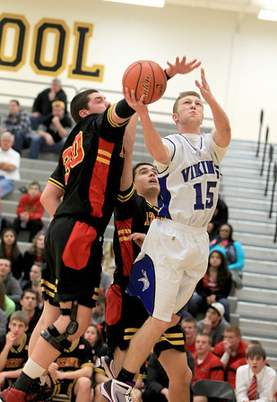 Sandy Bressner - sbressner@shawmedia.com<br /> Geneva's Phil Lorenz goes up for a shot as Cole Gardner of Batavia attempts a block during their first round regional game at Metea Valley Monday night.