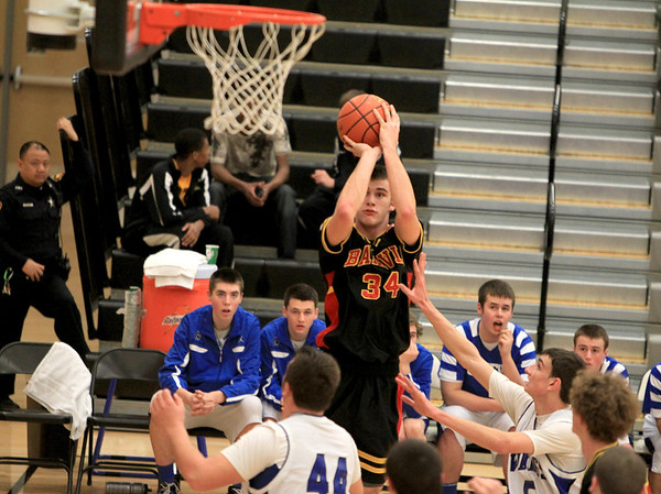 Sandy Bressner - sbressner@shawmedia.com<br /> Zach Strittmatter of Batavia goes for three during their first round regional game against Geneva at Metea Valley Monday night.