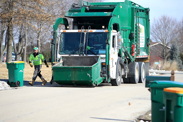 """Sandy Bressner - sbressner@shawmedia.com<br /> McCree """"Mac"""" Davis of Maple Park unloads recycled materials into his Waste Management truck during his route through Campton Hills Monday morning."""