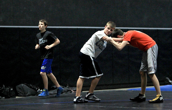 Sandy Bressner - sbressner@shawmedia.com<br /> St. Charles North wrestler Jordan Scalice (center) practices with teammate Eric Conrad at the school Thursday.