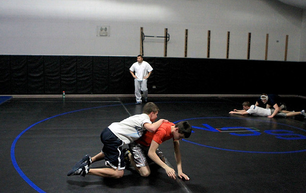 Sandy Bressner - sbressner@shawmedia.com<br /> St. Charles North wrestler Jordan Scalice (top) practices with teammate Eric Conrad at the school Thursday.